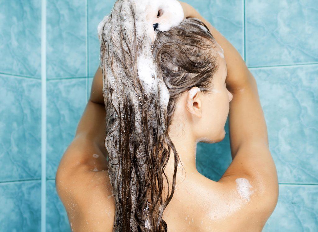 woman showering her hair
